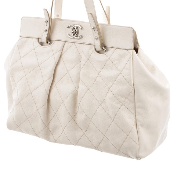 CHANEL Handbags - Chanel Ivory Quilted Leather CC Twist Lock Tote